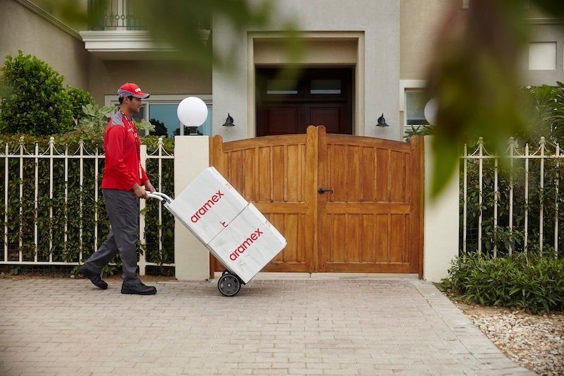 Aramex delivery person delivering packages
